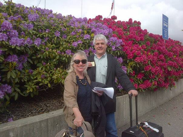 Corinne and Sigmund at the Bergen airport with Rhododendruns